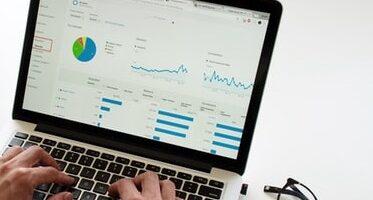 View of laptop screen displaying data analysis.