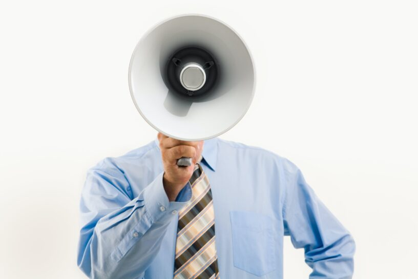 Man calling out with a megaphone