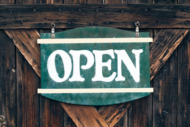 """Rustic sign which reads """"Open"""""""
